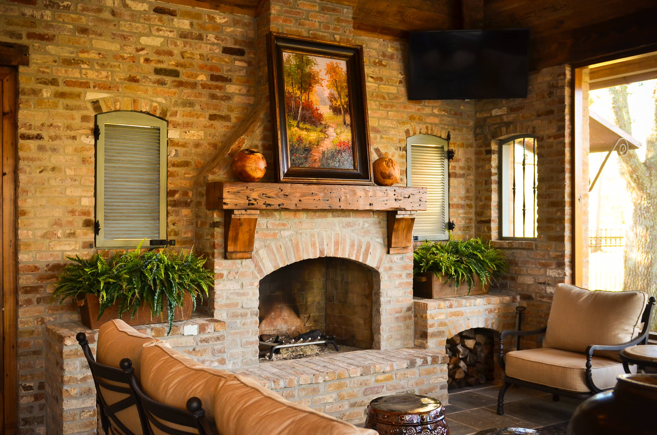 Rustic Living Room Plus Brick Fireplace And Fireplace Mantles With Outdoor Cushions For Outdoor Furniture Also Shutters And Brick Wall Plus Stool Garden With Wall Decor And Houseplant