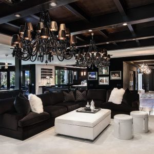 Sectional Sofa With Ottoman Coffee Table And Garden Stools For Contemporary Living Room Design With Black Chandelier And Ceiling Lights Plus Laminate Tile Flooring Also Ceiling Beams
