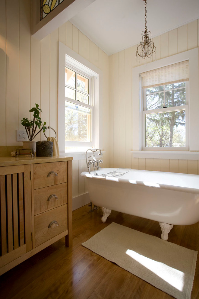 Single Hung Windows With Roler Blinds And Chandelier Also Claw Foot Tub With Wood Paneling For Walls And Bathroom Cabinet Plus Wood Flooring And Bath Mat