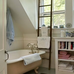 Small Bathrooms With Claw Foot Tub And Bath Mat Also Ladder Towel Rack With Single Hung Window And Bathroom Storage For Small Bathroom Plus Wainscoting