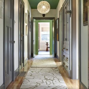 Small Hallway Ideas With Modern Rugs And Globe Chandelier Plus Ceilings And Front Entry Door With Wood Flooring Also Hallway Storage Anad Door Molding