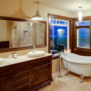 Soaking Tub With Glass Shower Panel And Tile Flooring For Traditional Bathroom Design With Pendant Lighting And Bathroom Vanity Cabinets Plus Vessel Sink Faucets Also Vanity Mirror