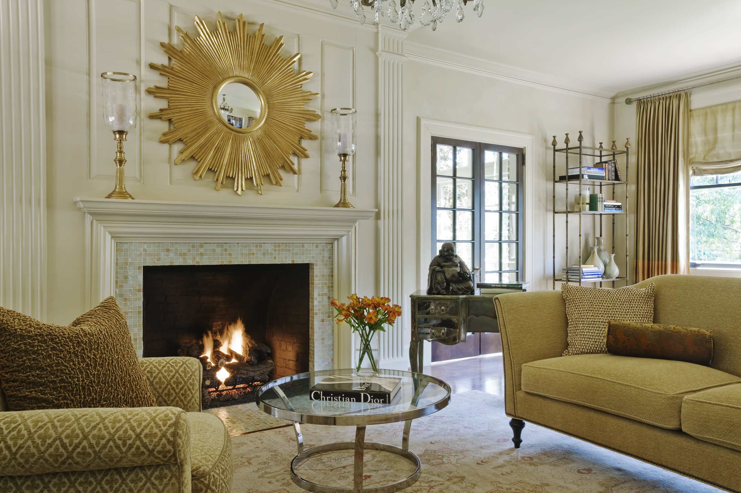 bedroom sunburst mirrors above fireplace plus glass candle