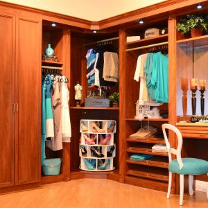 Traditional Closet With Beige Wall Plus Built In Closet And Built In Closet Storage Also Shoe Racks In Dressing Room With Leaning Shelves Plus Makeup Vanity And Wood Cabinets On Polish Wood Flooring