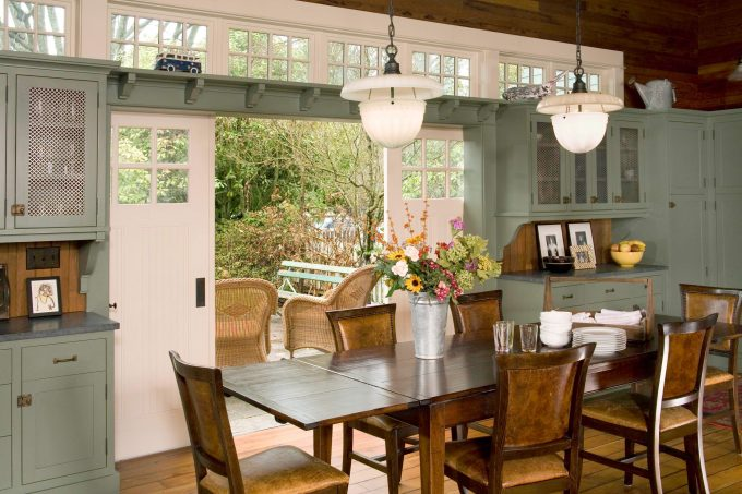Traditional Dining Room With Dining Table Designs Plus Leather Upholstery Dining Chairs Also Metal Wire Upper Cabinet Doors With Pendant Lights On Tongue And Groove Backsplash Plus Transom Windows