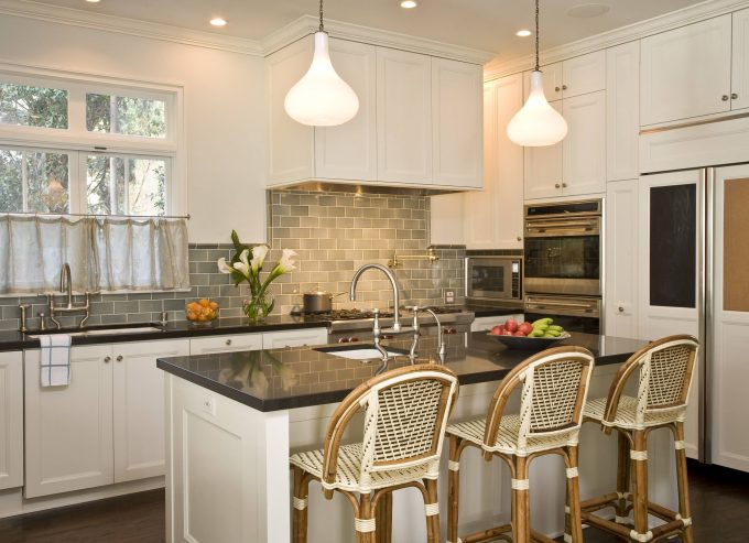 Traditional Kitchen Plus Backsplashes And Breakfast Bar With Bridge Faucet Plus Custom Cabinetry Also Island Lighting And Kitchen Hardware With Microwave Plus Stainless Steel Appliances
