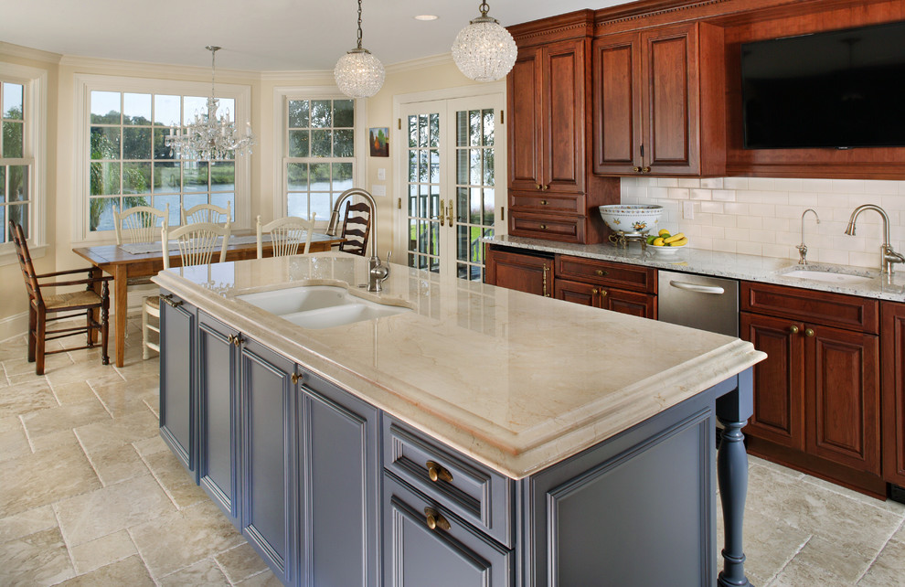 Traditional Kitchen Plus Crema Marfil Marble For Countertop With Bar Sink And Blue Accents Plus Cherry Cabinetry Also Kitchen Island With Marble Flooring Plus Pendant Lights