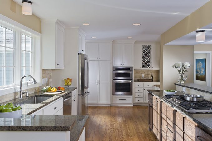Traditional Kitchen With Red Oak Flooring Plus Island Granite And Undermount Sink Completed By Simple Faucet Also Recessed Lighting On White Ceiling With Window Treatment