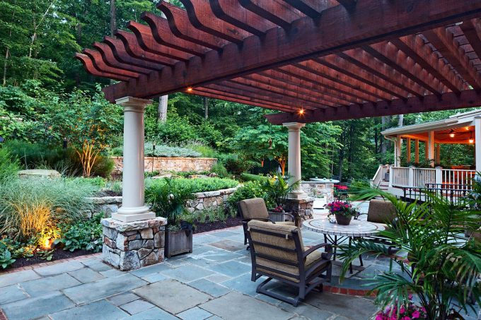 Traditional Patio With Arbor Plus Column And Garden Also Outdoor Dining Table For Pergola Ideas Plus Palm And Stone Patio With Stone Wall Also Garden Lighting Ideas With Round Coffee Table