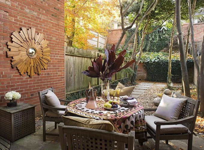 Traditional Patio With Decorations For Patio Plus Sunburst Mirrors On Brick Wall Exterior Also Wood Fence And Climbing Plants With Concrete Walkway Plus Outdoor Furniture Also Cushion