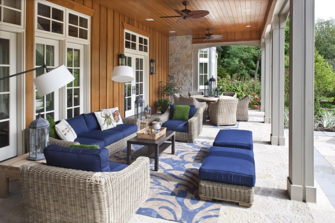 Traditional Porch With Board And Batten Wood Siding Plus Ceiling Fan With Outdoor Cushions On Wicker Furniture Also Hammary Furniture Plus Outdoor Lighting And Outdoor Rug For Decorating Patio