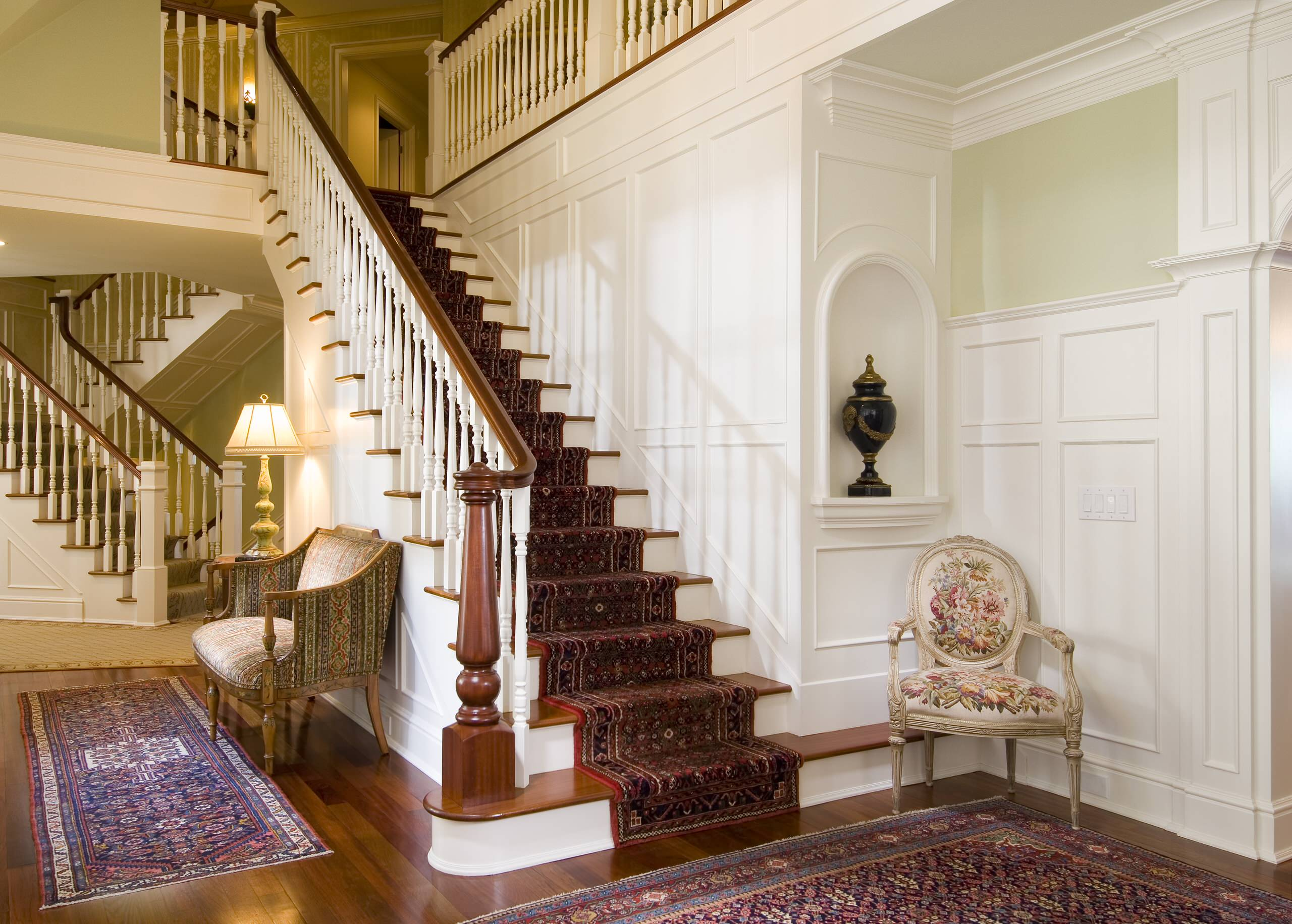 Inspiring Decorative Wall Panels with Visual Effect for Your Home: Traditional Staircase Plus Stair Carpet And Dark Stained Wood In Modern Home With Decorative Wall Panels And Hardwood Flooring Plus Persian Rug Also Railing With Spindle And Wainscot