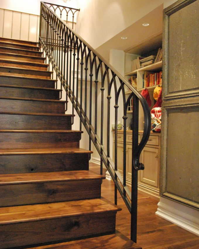 Traditional Staircase With Architectural Plus Iron Railings And Bookshelf Also Cabinets With Recessed Lighting For Hallway Plus Pickets And Drawes Also Storage With Hardwood Flooring