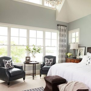 Transitional Bedroom Plus Pattern Rug And Bed Plus Dark Footstool Also Leather Chairs With Clerestory Windows Plus Transom And Chandelier In Master Bedroom With Best Interior Paint