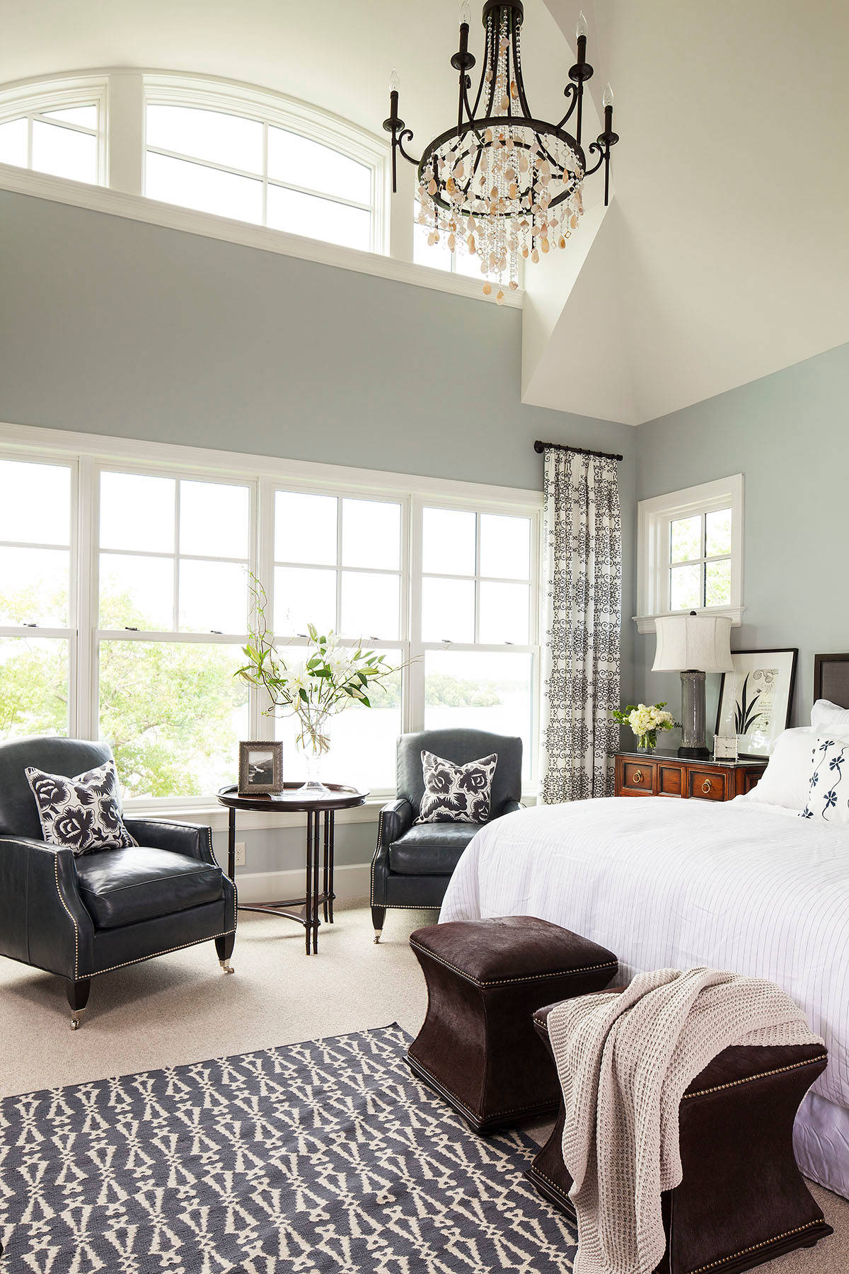 Interesting Home Using Best Interior Paint Ideas: Transitional Bedroom Plus Pattern Rug And Bed Plus Dark Footstool Also Leather Chairs With Clerestory Windows Plus Transom And Chandelier In Master Bedroom With Best Interior Paint