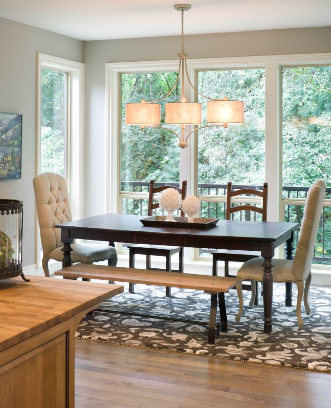 Transitional Dining Room With Patterned Rug Plus Bench And Dark Wood Dining Table Also Upholstered Chairs For Decorating Dining Room With Large Windows Plus Light Fixture Also Open Concept And Drum Chandelier