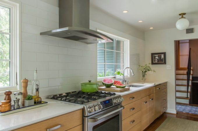 Transitional Kitchen With Dal Tile And Exhaust Hood Plus Recessed Lighting Also Pendant Light With Large Windows Also Refacing Cabinets And Hardwood Flooring Plus Kitchen Mat