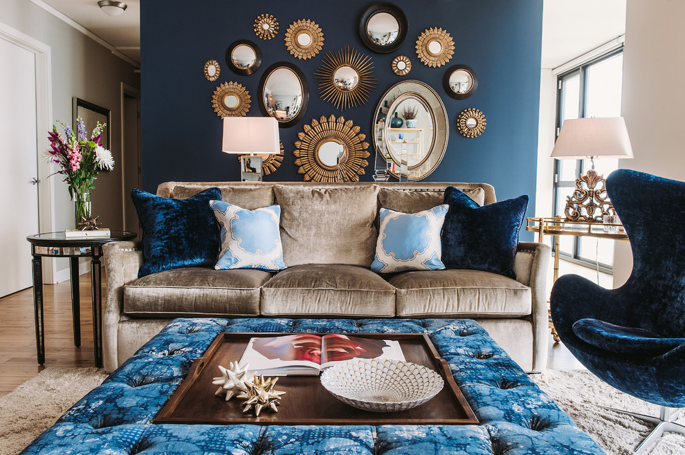 Transitional Living Room With Dark Blue Accent Wall Plus Sunburst Mirrors Also Decorative Pillows For Couches