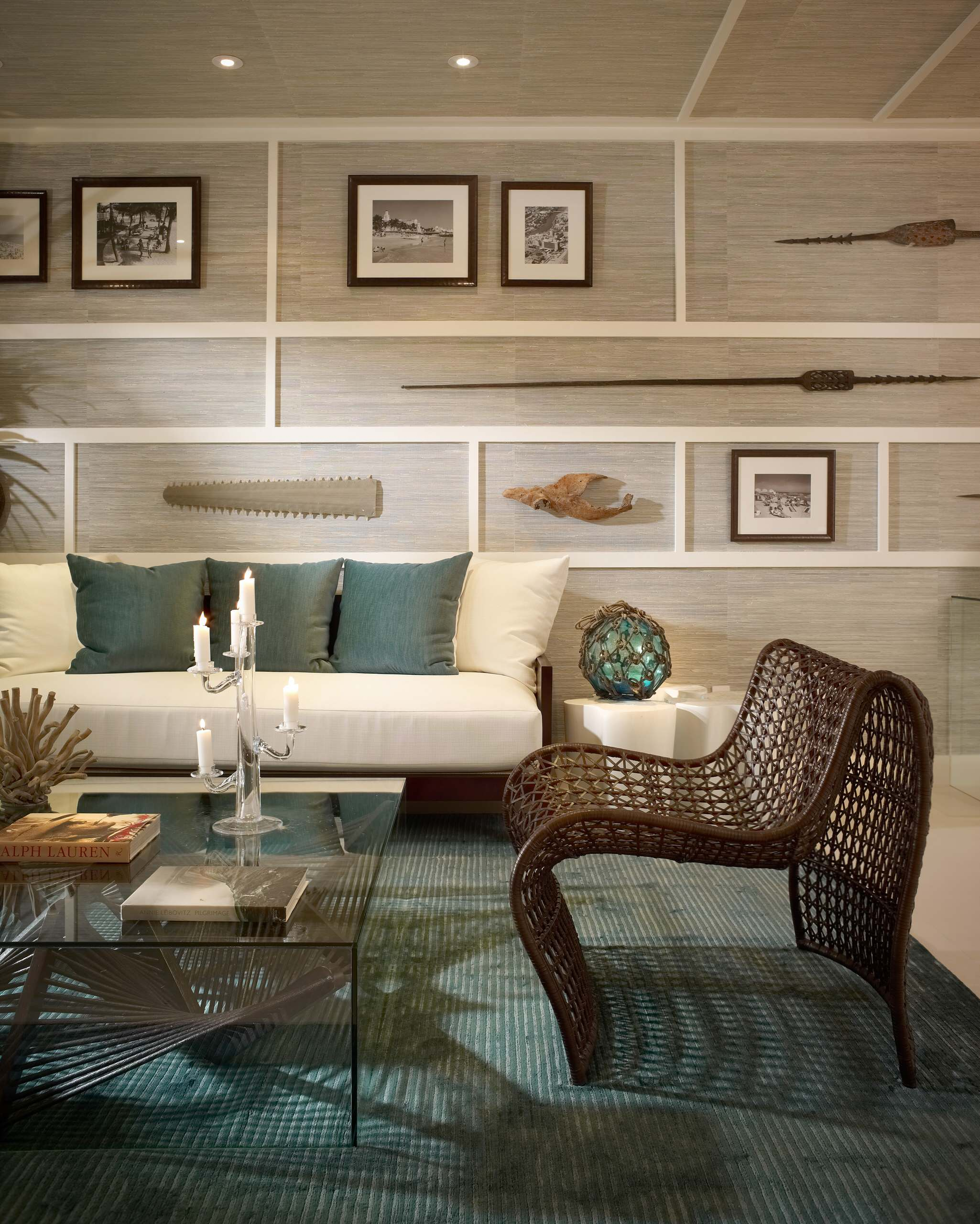 Inspiring Decorative Wall Panels with Visual Effect for Your Home: Tropical Living Room With Decorative Wall Panels Plus Wall Decor And Ceiling Lighting With Glass Coffee Table On Turquoise Rug Also Cushion On White Sofa And Woven Armchair Plus Candle