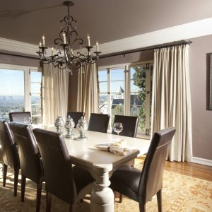 Upholstered Dining Chairs With Rustic Dining Table And Black Chandelier In Transitional Dining Room With Sunroom Windows And Crown Molding Plus Baseboard Also Feizy Rug