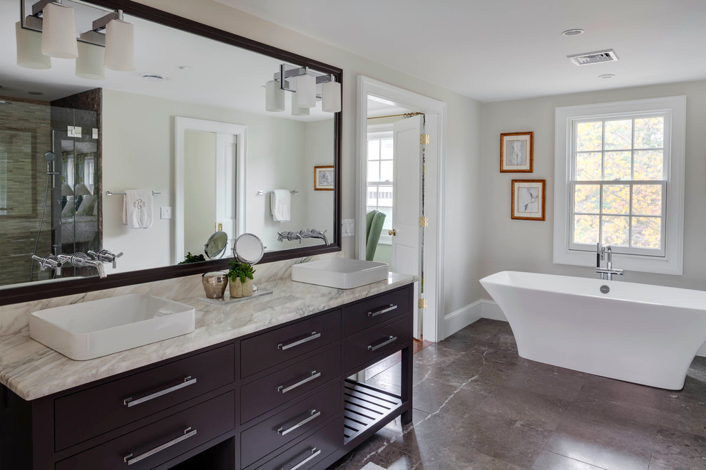 Vanity Lights With Mirrored Vanity And Double Sink Vanity For Traditional Bathroom Design With Vessel Sink Faucets And Towel Bar Plus Granite Flooring Also Soaking Tub