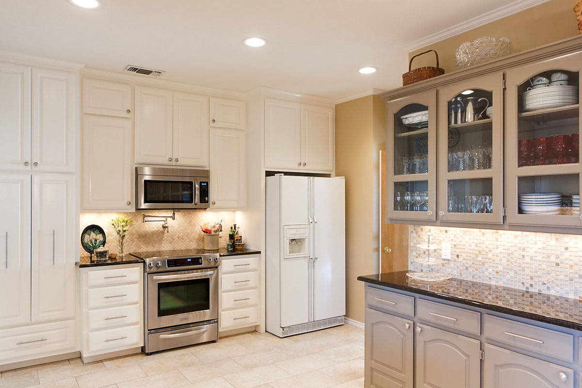 Pot Filler for Inspiring Water Instalation Ideas: White Kitchen Cabinets With Under Cabinet Microwave And Under Cabinet Lighting In Traditional Kitchen With Mosaic Tile Blacksplash And Pot Filler Plus Electric Stove Also Laminate Tile Flooring
