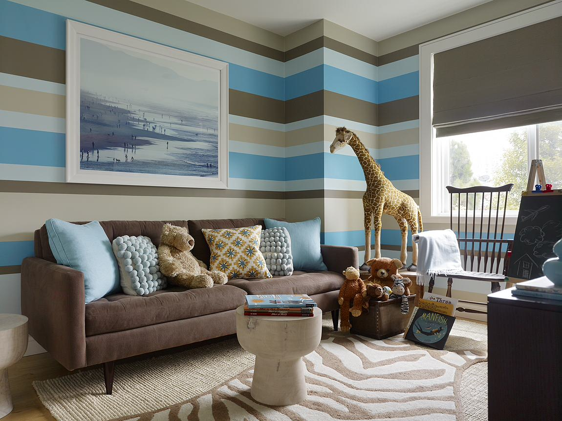 Home Interior Decor with Stunning Zebra Rug: Zebra Rug With Chalkboard Wall And Window Shades Also Blue And Brown Walls Plus Windsor Chair And Brown Sofa Also Glass Windows For Modern Playroom Design
