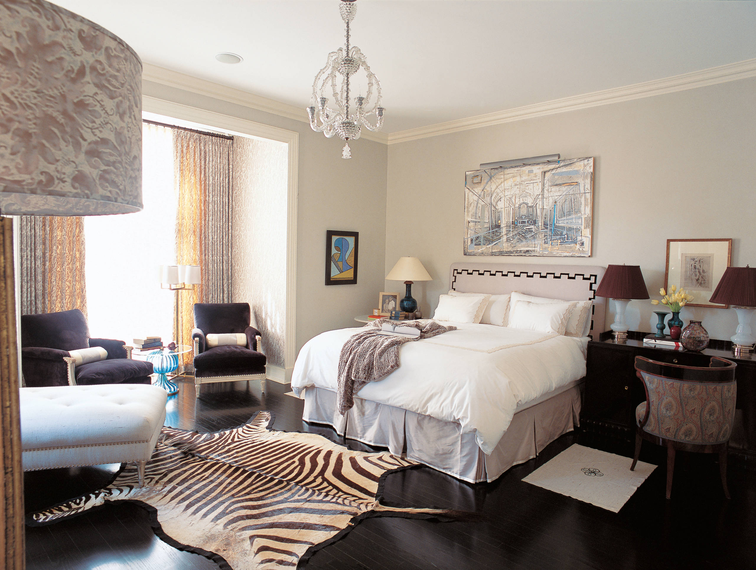 Zebra Rug With Dark Wood Floors And Contemporary Curtains Also White Bedding Plus Velvet Armchairs And Upholstered Headboard For Modern Bedroom Design