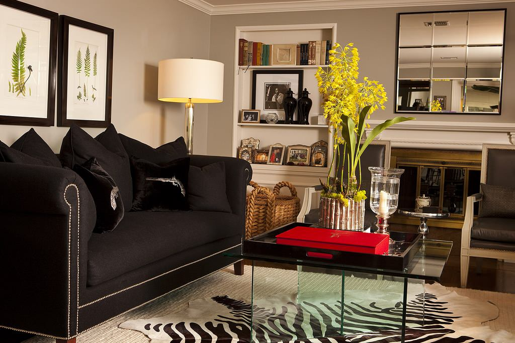 Home Interior Decor with Stunning Zebra Rug: Zebra Rug With Floor Lamps And Fireplace Screen Also Glass Coffee Plus Crown Molding And Black Sofa Also Beveled Mirror Plus Wall Art And Container Plants For Modern Living Room