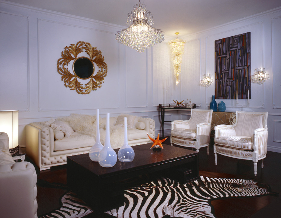 Home Interior Decor with Stunning Zebra Rug: Zebra Rug With Modern Crystal Chandelier And Modern Coffee Table Also Sunburst Mirror Plus Wooden Flooring And White Walls Also White Sofa For Modern Living Room