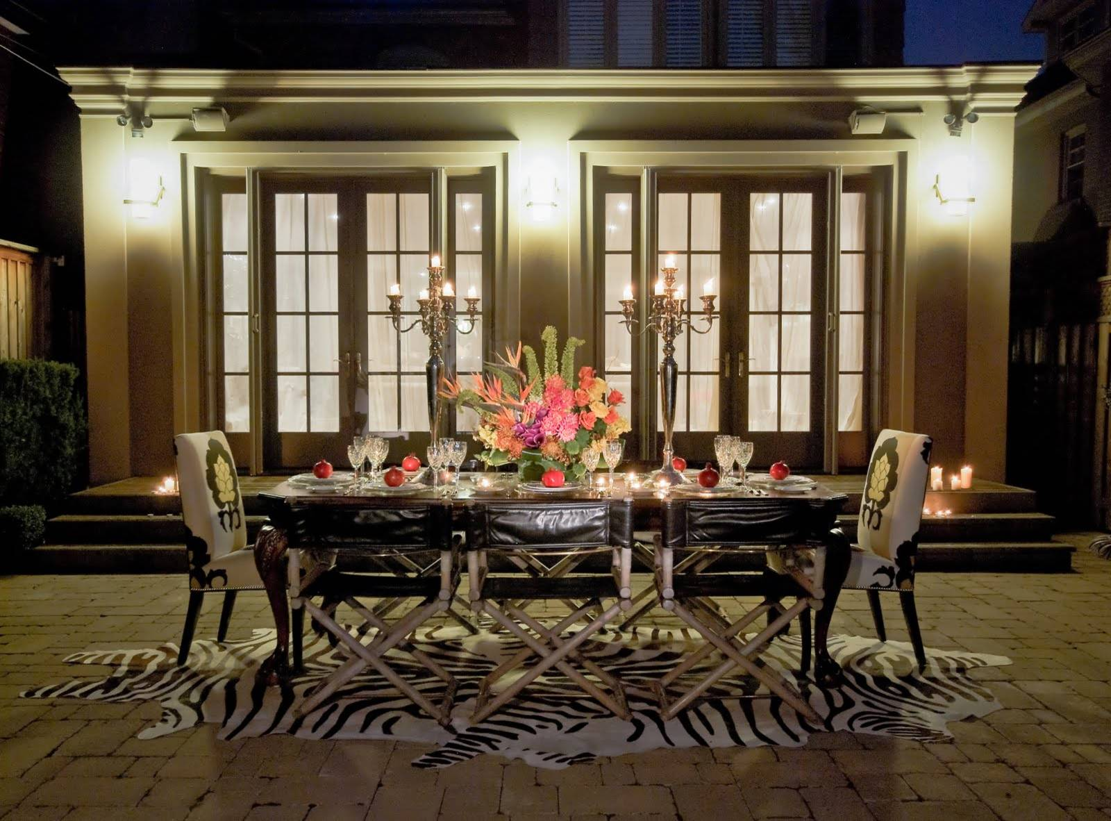 Home Interior Decor with Stunning Zebra Rug: Zebra Rug With Wall Sconces And French Doors Also Floral Arrangement Plus Candelabra And Outdoor Dining Table Also Crown Molding For Modern Patio Furniture