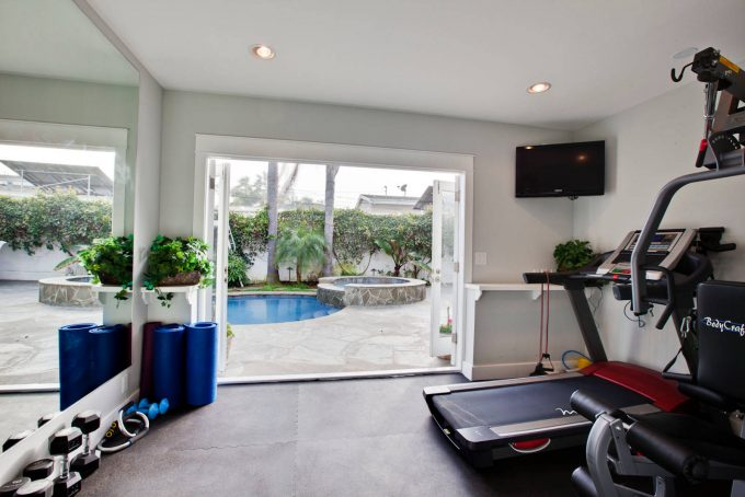 Apartment Small Home Gyms With Pool House Designs And Small Gym Windows Plus Pool Spa With Stone Wall Also Concrete Flooring And Recessed Lighting In Small Gym Room