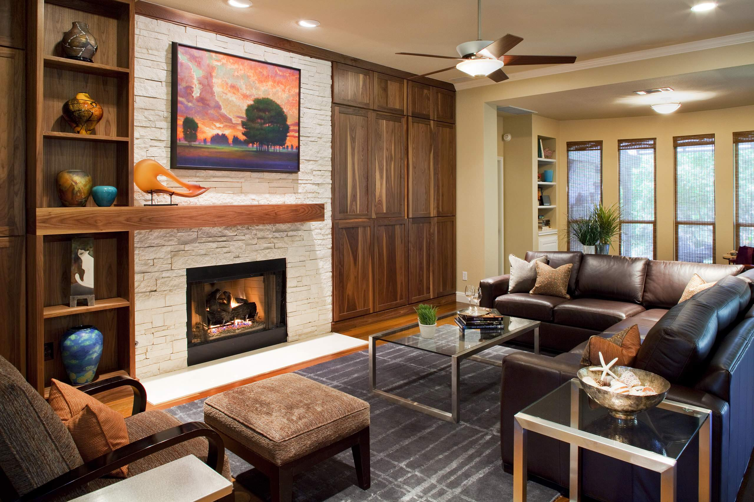 Awesome Mantel Design Ideas for Fireplace In Your Home: Area Rug In Contemporary Living Room Plus Built In Shelves And Built In Storage Also Ceiling Fan With Ceiling Lighting Plus Contemporary Fireplace And Mantel Also Corner Sofa