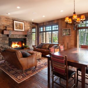 Barn Board And Dark Wood For Mantel In Rustic Living Room With Dark Wood Flooring Plus Dining Room Also Eco Friendly And Hardwood With Wrought Iron Chandelier And Recessed Lighting