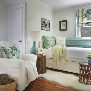 Beach Cottage Bedroom With Hardwood Flooring Plus Woven Basket And Blue Patterned Fabric Also Day Bed For Guest Bedroom With Roman Shades And Runner Rug Also Armchair