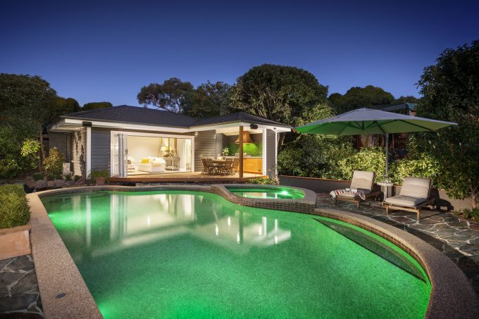 Beige Exterior Plus Beige Outdoor Cushions For Lounge Chairs With Outdoor Umbrella And Covered Deck Also Green Pool Lighting Plus Hot Tub With Pool House Designs