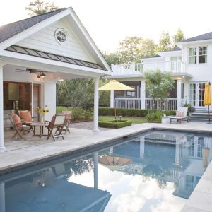 Bifold Doors Also Coffee Table Plus Orange Cushions For Patio Furniture And Pool Umbrella With Rectangular Pool And Pool House Designs Also Sunflowers In White House