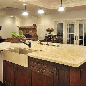 Brick Fireplace Surround For Kitchen Design Ideas With Ceiling Lighting And Coffered Ceiling Plus Dark Wood Cabinets Also Apron Sink With Kitchen Hardware Also Pendant Lighting
