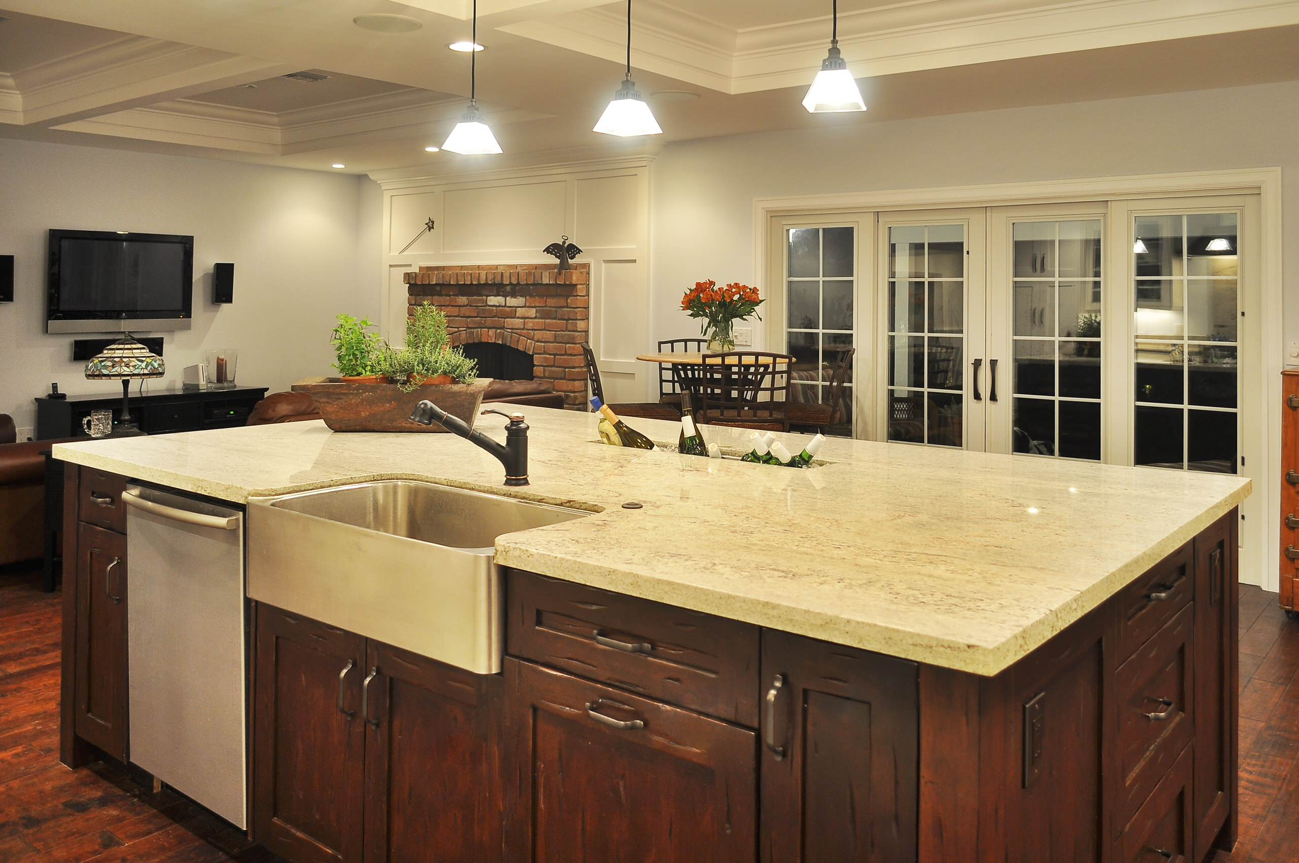 Inspiring Kitchen Decor plus Apron Sink Ideas: Brick Fireplace Surround For Kitchen Design Ideas With Ceiling Lighting And Coffered Ceiling Plus Dark Wood Cabinets Also Apron Sink With Kitchen Hardware Also Pendant Lighting