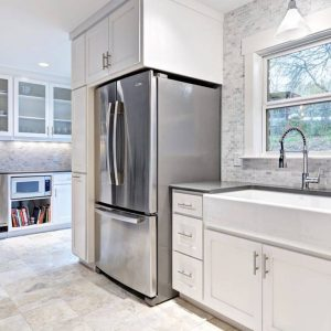 Carrara Marble And Mosaic Tile In Contemporary Kitchen Plus Quartz Countertop And Apron Sink Also Stainless Steel Appliances With Under Cabinet Lighting And White Cabinets