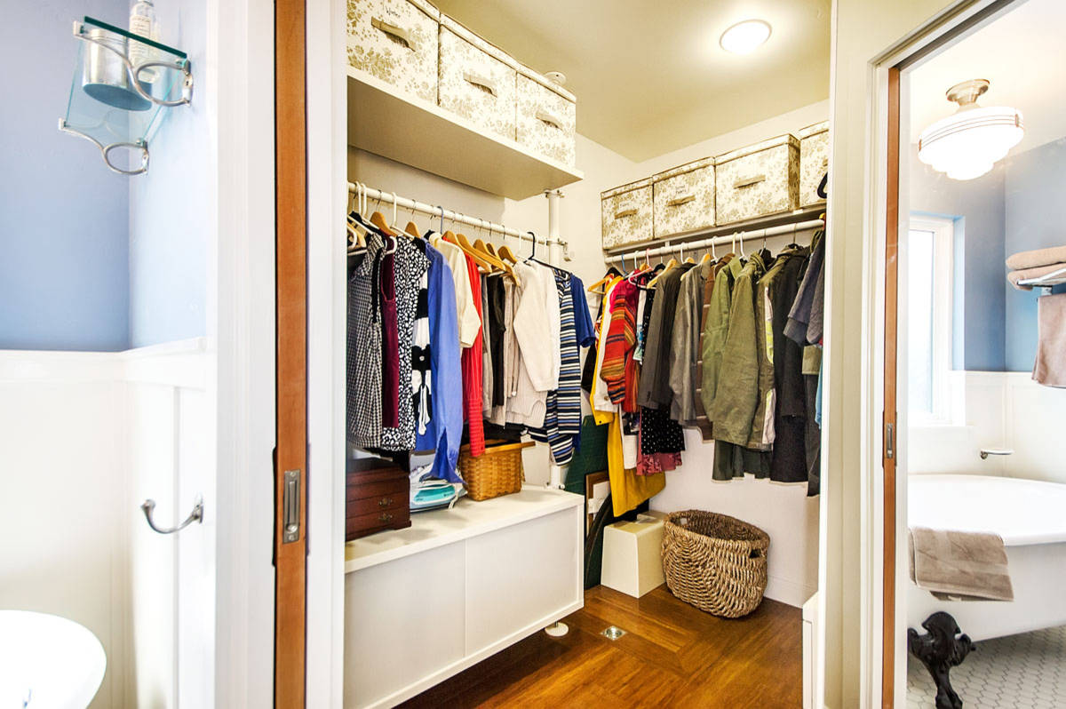 Ceiling Lighting In Traditional Closet With Corner Closet Plus Pocket Doors Also Storage Boxes And Wainscoting With Walk In Closet And Wood Flooring Plus Storage Basket