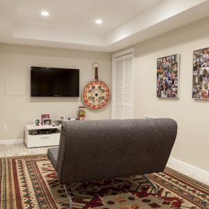 Contemporary Basement Plus Area Rug And Baseboards With Ceiling Lighting Also Flat Screen Tv For Media Room With Sleeper Sofa And Tan Walls Plus Photo Collage Ideas Also White Trim