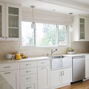 Frosted Glass Cabinet And Pendant Light Also Stainless Steel With Subway Tile Plus White Cabinet In Kitchen Plus Apron Sink Also Window Shades With Wood Flooring And Recessed Lighting