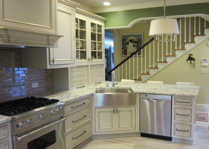 Inspiring Decorating Kitchen With Arched Header And Circa Lighting Chandelier Plus Custom Backsplash Also Glass Cabinet Doors With Apron Sink And Granite Countertop Also Hidden Storage