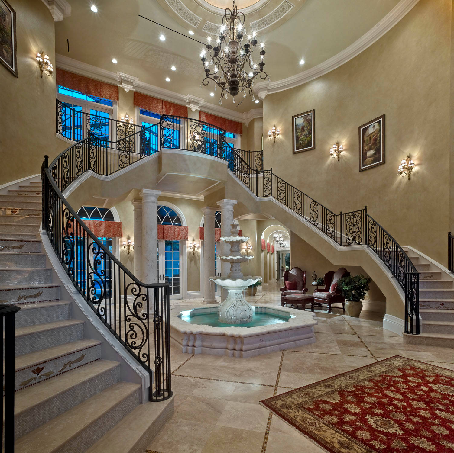 Mediterranean Staircase Plus Arched Window And Beige Faux Finish Wall With Beige Tile Floor And Ceiling Design Plus Ceiling Medallion Also Indoor Fountains And Metal Chandelier