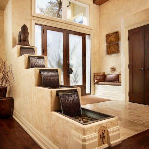 Rustic Entry Plus Aquatic And Built In Bench With Cushion Also Clerestory Windows With Double Doors Plus Indoor Fountains And Hardwood Flooring Also Sculpture With Tall Ceiling