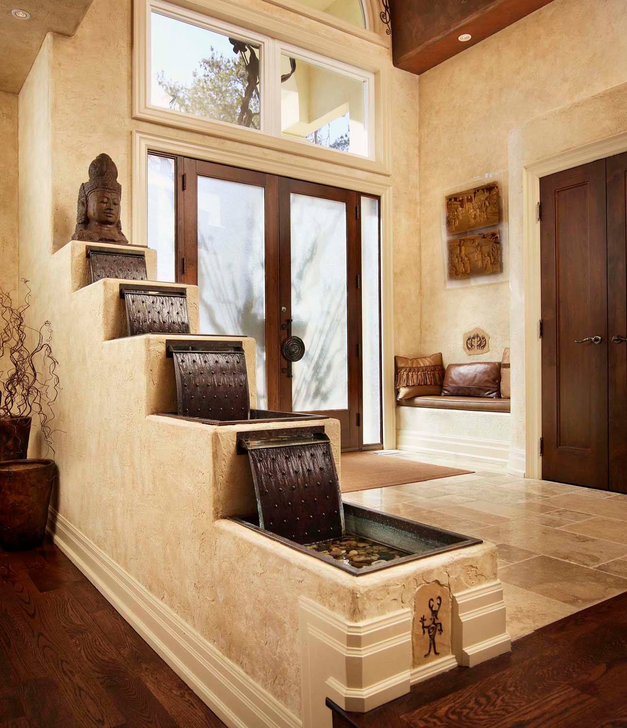 Indoor Fountains Design Ideas for Interior Decor Your Home: Rustic Entry Plus Aquatic And Built In Bench With Cushion Also Clerestory Windows With Double Doors Plus Indoor Fountains And Hardwood Flooring Also Sculpture With Tall Ceiling