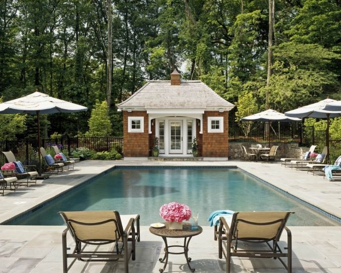 Traditional Pool With Pool House Designs Also Bluestone And Curved Roofline Plus Lounge Chair With Metal Fence And Sidelites Also Side Table With Tile Coping And Outdoor Umbrella