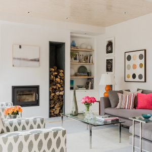 Transitional Family Room With Built In Bookcase And Storage Boxes Plus Colorful Accent Pillows Also Decorative Pillows For Couches With Glass Coffee Table And Gray Couch