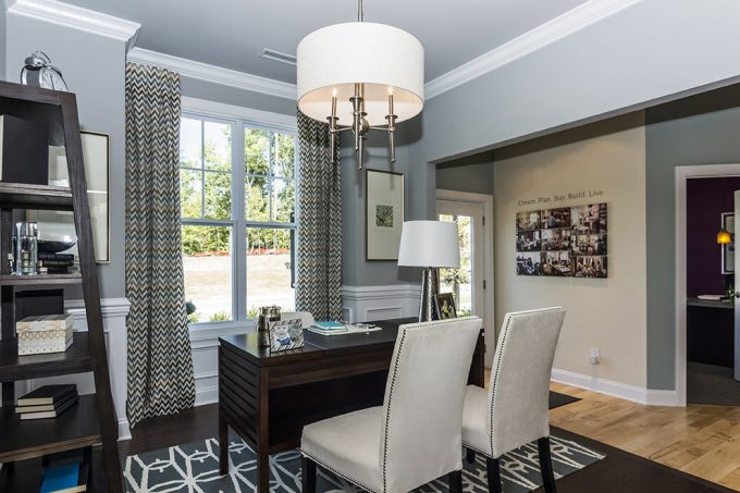 Transitional Home Office With Chevron Window Treatment Also Crown Molding Plus Photo Collage Ideas On Light Blue Walls With Light Wood Floor And Pattern Gray Rug Plus Drum Chandelier